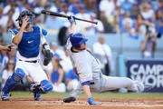 Jon Lester #34 of the Chicago Cubs falls to the ground after a wild pitch in the third inning during Game Two of the National League Championship Series against the Los Angeles Dodgers at Dodger Stadium on October 15, 2017 in Los Angeles, California.