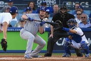 Jon Lester #34 of the Chicago Cubs attempts to bunt in the third inning against the Los Angeles Dodgers during game two of the National League Championship Series at Dodger Stadium on October 15, 2017 in Los Angeles, California.