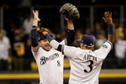 Orlando Arcia #3 and Ryan Braun #8 of the Milwaukee Brewers celebrate after defeating the Los Angeles Dodgers in Game Six of the National League Championship Series at Miller Park on October 19, 2018 in Milwaukee, Wisconsin.