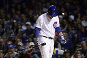 Anthony Rizzo #44 of the Chicago Cubs walks back to the dugout after striking out in the fourth inning against the Los Angeles Dodgers during game four of the National League Championship Series at Wrigley Field on October 18, 2017 in Chicago, Illinois.