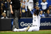 Ryan Braun #8 of the Milwaukee Brewers celebrates after scoring a run off of a double hit by Jesus Aguilar #24 of the Milwaukee Brewers during the first inning in Game Six of the National League Championship Series at Miller Park on October 19, 2018 in Milwaukee, Wisconsin.
