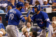 Jose Bautista #19 of the Toronto Blue Jays celebrates with Chris Colabello #15 after he hits a solo home run in the fourth inning against the Kansas City Royals in game six of the 2015 MLB American League Championship Series at Kauffman Stadium on October 23, 2015 in Kansas City, Missouri.