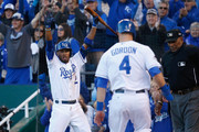 Alcides Escobar #2 of the Kansas City Royals celebrates as Alex Gordon #4 of the Kansas City Royals scores a run in the seventh inning against the Toronto Blue Jays during game two of the American League Championship Series at Kauffman Stadium on October 17, 2015 in Kansas City, Missouri.