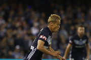 Keisuke Honda of the Victory runs with the ball during the round one A-League match between Melbourne Victory and Melbourne City at Marvel Stadium on October 20, 2018 in Melbourne, Australia.