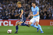Keisuke Honda of the Victory passes the ball during the round one A-League match between Melbourne Victory and Melbourne City at Marvel Stadium on October 20, 2018 in Melbourne, Australia.