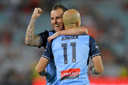 Adrian Mierzejewski of Sydney celebrates with Luke Wilkshire of Sydney after scoring a goal during the round 10 A-League match between the Western Sydney Wanderers and Sydney FC at ANZ Stadium on December 9, 2017 in Sydney, Australia.  (Photo by Brett Hemmings/Getty Images) *** Local Caption *** Adrian Mierzejewski; Luke Wilkshire