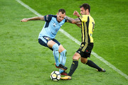 Luke Wilkshire of Sydney FC is tackled by Tom Doyle of the Phoenix during the round 12 A-League match between the Wellington Phoenix and Sydney FC at Westpac Stadium on December 23, 2017 in Wellington, New Zealand.