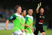 Ufuk Talay (L) of the Fury celebrates his goal with Brad McDonald and Ramazan Tavsancioglu  during the round 18 A-League match between the North Queensland Fury and Sydney FC at Dairy Farmers Stadium on December 15, 2010 in Townsville, Australia.