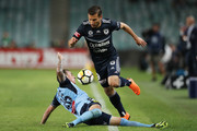 Kosta Barbarouses of the Victory takes on Luke Wilkshire of Sydney FC during the A-League Semi Final match between Sydney FC and Melbourne Victory at Allianz Stadium on April 28, 2018 in Sydney, Australia.