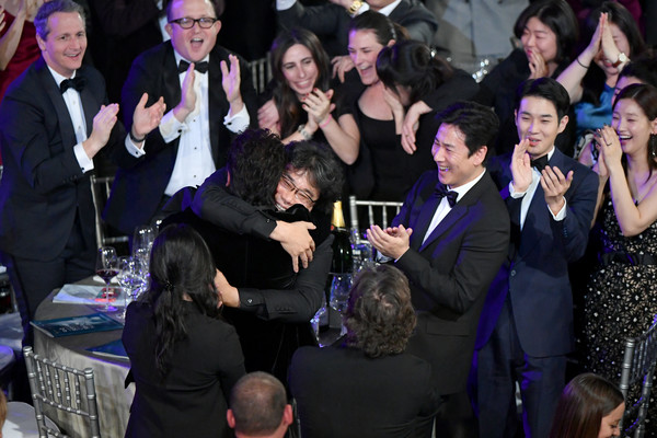 26th Annual Screen ActorsGuild Awards - Inside [motion picture,outstanding performance by a cast,event,formal wear,performance,crowd,party,ceremony,cast,screen actors guild awards,parasite,award,the shrine auditorium,los angeles,california,screen actors\u00e2 guild awards,kang-ho song,bong joon-ho,park so-dam,lee jeong-eun,cho yeo-jeong,choi woo-shik,lee sun gyun,parasite,jang hye-jin,yang-kwon moon]