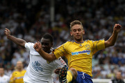 Lloyd Sam of Leeds United in action with James Bailey of Derby County during the npower Championship match between Leeds United and Derby County at Elland Road on August 7, 2010 in Leeds, England.