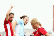 """Diego Forlan (C) competes for the ball with Marina Fedorova  during the Legends Football Match in """"The park of Soccer and rest"""" at Red Square on July 11, 2018 in Moscow, Russia."""