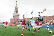 """Marina Fedorova (L) and  Diego Forlan compete during the Legends Football Match in """"The park of Soccer and rest"""" at Red Square on July 11, 2018 in Moscow, Russia."""