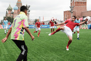 """Diego Forlan (R) controls the ball during the Legends Football Match in """"The park of Soccer and rest"""" at Red Square on July 11, 2018 in Moscow, Russia."""