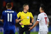 Referee Daniele Orsato of Italy shows a second yellow card to Samir Nasri of Sevilla during the UEFA Champions League Round of 16, second leg match between Leicester City and Sevilla FC at The King Power Stadium on March 14, 2017 in Leicester, United Kingdom.
