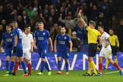 Referee Daniele Orsato of Italy shows the red card to Samir Nasri of Sevilla during the UEFA Champions League Round of 16, second leg match between Leicester City and Sevilla FC at The King Power Stadium on March 14, 2017 in Leicester, United Kingdom.
