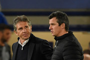 Claude Puel, Manager of Leicester City and Joey Barton, Manager of Fleetwood Town speak after the Carabao Cup Second Round match between Leicester City and Fleetwood Town at The King Power Stadium on August 28, 2018 in Leicester, England.
