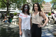 Actress, Michelle Ryan poses for a photo with a zombie prior to talking about her new film 'Cockneys v Zombies' at an event to mark the opening of the new look Leicester Sqaure which opens this week at Leicester Square on May 27, 2012 in London, England.  The programme of relaunch events includes a celebration of Film4 FrightFest the 13th, which returns on August 23, 2012.