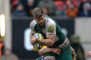 Michael Fitzgerald of Leicester Tigers tackled by Ross Harrison of Sale Sharks during the Aviva Premiership match between Leicester Tigers and Sale Sharks at Welford Road on February 6, 2016 in Leicester, England.