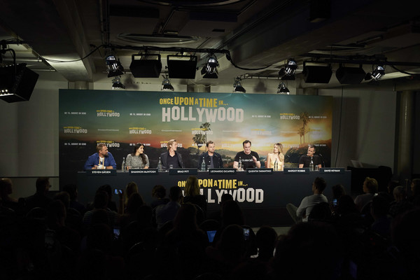 'Once Upon A Time... In Hollywood' Press Junket At Soho House [once upon a time,press junket,press junket,stage,projection screen,event,auditorium,convention,technology,crowd,audience,performance,electronic device,quentin tarantino,leonardo dicaprio,shannon mcintosh,brad pitt,l-r,soho house,hollywood]