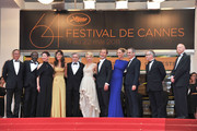 "(L-R) Jury Members Mahamat-Saleh Haroun, Johnnie To, Nansun Shi, Martina Gusman, Jury President Robert De Niro, Linn Ullmann, Jude Law, Uma Thurman, Olivier Assayas, Thierry Fremaux, and Gilles Jacob  attend the ""Les Bien-Aimes"" premiere at the Palais des Festivals during the 64th Cannes Film Festival on May 22, 2011 in Cannes, France."