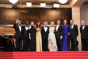 "(L-R) Jury Members Mahamat-Saleh Haroun, Johnnie To, Nansun Shi, Martina Gusman, Jury President Robert De Niro, Linn Ullmann, Jude Law, Uma Thurman, Olivier Assayas, and Thierry Fremaux attend the ""Les Bien-Aimes"" premiere at the Palais des Festivals during the 64th Cannes Film Festival on May 22, 2011 in Cannes, France."