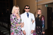 Malin Akerman, Johnson Hartig and Fergie attend the Libertine Fall 2019 Runway Show at Ebell of Los Angeles on April 26, 2019 in Los Angeles, California.