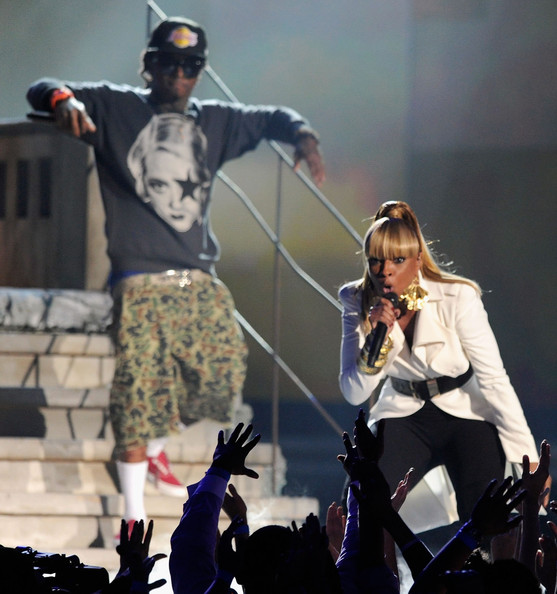 Lil Wayne Rapper Lil Wayne (L) and singer Mary J. Blige perform onstage during the 2011 Billboard Music Awards at the MGM Grand Garden Arena May 22, 2011 in Las Vegas, Nevada.