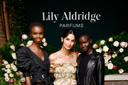 Akiima, Lily Aldridge, and guest pose for a photo  Lily Aldridge parfums launch event at The Bowery Terrace at the Bowery Hotel on September 08, 2019 in New York City.