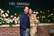 Derek Blasberg and Lily Aldridge pose for a photo during the Lily Aldridge parfums launch event at The Bowery Terrace at the Bowery Hotel on September 08, 2019 in New York City.