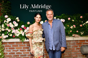 Lily Aldridge and Jean Madar .pose for a photo during the Lily Aldridge parfums launch event at The Bowery Terrace at the Bowery Hotel on September 08, 2019 in New York City.