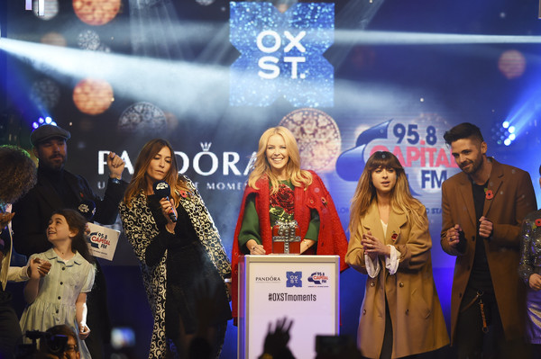 Kylie Minogue Switches on the World Famous Oxford Street Christmas Lights with Pandora [product,event,performance,award ceremony,stage,ceremony,fashion design,world,kylie minogue,global superstar kylie minogue,evie hone,c lights,l-r,oxford street,fleur east,pandora,pandora switch on,world famous oxford street christmas lights]