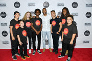 Trombone Shorty poses with students of Little Kids Rock during the Little Kids Rock Benefit 2019 at PlayStation Theater on October 10, 2019 in New York City.