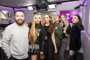 Kiss presenters Tom Green and Daisy Maskell pose with (L-R) Jesy Nelson, Jade Thirlwall, Leigh-Anne Pinnock and Perrie Edwards of Little Mix visit Kiss FM on February 04, 2019 in London, England.