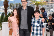 """Mackenzie Foy, director Mark Osborne and Riley Osborne attend a photocall for """"The Little Prince"""" during the 68th annual Cannes Film Festival on May 22, 2015 in Cannes, France."""