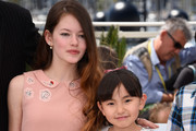 """Rio Suzuki and Mackenzie Foy attend a photocall for """"The Little Prince"""" during the 68th annual Cannes Film Festival on May 22, 2015 in Cannes, France."""