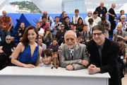 """Asaka Seto, Rio Suzuki, Masahiko Tsugawa and director Mark Osborne attends a photocall for """"The Little Prince"""" during the 68th annual Cannes Film Festival on May 22, 2015 in Cannes, France."""