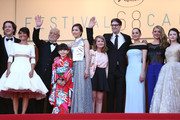 """(2ndL-R) Florence Foresti, Masahiko Tsugawa, Rio Suzuki, Asaka Seto, Clara Poincare, Marion Cotillard, Charlotte Vandermeersch, Mackenzie Foy and Riley Osborne attend the Premiere of """"The Little Prince"""" during the 68th annual Cannes Film Festival on May 22, 2015 in Cannes, France."""