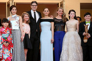 """(L-R) Rio Suzuki, Asaka Seto, guest, Director Mark Osborn, Marion Cotillard, Charlotte Vandermeersche, Mackenzie Foy and Riley Osborne  attend the Premiere of """"The Little Prince"""" during the 68th annual Cannes Film Festival on May 22, 2015 in Cannes, France."""