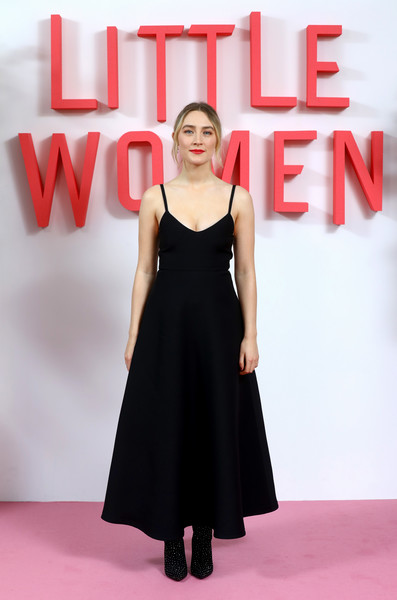 Saoirse Ronan kept it low-key in a black spaghetti-strap dress by Valentino at the 'Little Women' evening photocall in London.