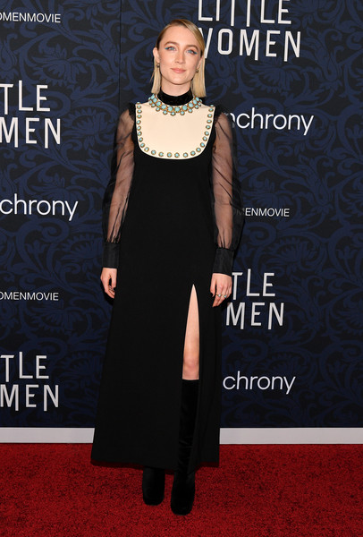 Saoirse Ronan opted for a black Gucci gown with a contrast leather bib accent and blue stone embellishments when she attended the world premiere of 'Little Women.'