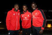 Liverpool FC players (L-R) Kolo Toure, Sheyi Ojo and Mamadou Sakho arrive to rename Caxton st as Anfield Road to celebrate the arrival of Liverpool FC on July 16, 2015 in Brisbane, Australia. Liverpool FC are in Queensland to play the Brisbane Roar at Suncorp Stadium on the first leg of their Australian tour