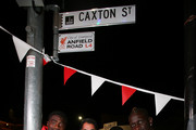 Queensland Rugby League legend and Liverpool FC fan Mal Meninga with Liverpool FC players (L-R) Kolo Toure, Sheyi Ojo and Mamadou Sakho at the renaming of Caxton st as Anfield Road to celebrate the arrival of Liverpool FC on July 16, 2015 in Brisbane, Australia. Liverpool FC are in Queensland to play the Brisbane Roar at Suncorp Stadium on the first leg of their Australian tour