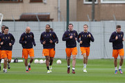 Jamie Carragher,Steven Gerrard;Glen Johnson,Jordan Henderson,Jonjo Shelvey and Stewart Downing warm up during a training session ahead of their UEFA Europa League group match against FC Anzhi Makhachkala at Melwood Training Ground on October 24, 2012 in Liverpool, England.