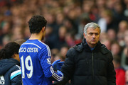 Jose Mourinho manager of Chelsea shakes hands with Diego Costa of Chelsea as he is substituted during the Barclays Premier League match between Liverpool and Chelsea at Anfield on November 8, 2014 in Liverpool, England.
