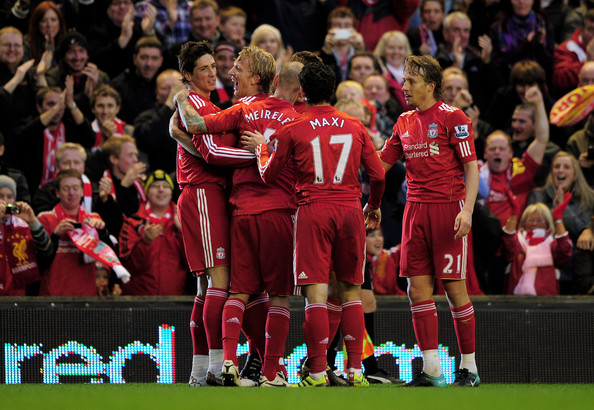 Fernando Torres (L) of Liverpool  is congratulated by his team mates after scoring the opening goal during the Barclays Premier League match between Liverpool and Chelsea at Anfield on November 7, 2010 in Liverpool, England.