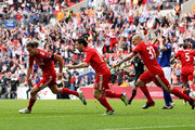 (L-R) Andy Carroll of Liverpool celebrates with Maxi Rodriguez, Martin Skrtel as he scores their second goal during the FA Cup with Budweiser Semi Final match between Liverpool and Everton at Wembley Stadium on April 14, 2012 in London, England.