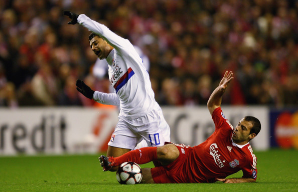 Ederson Javier Mascherano of Liverpool tackles Ederson of Lyon during the UEFA Champions League Group E match between Liverpool and Lyon at Anfield on October 20, 2009 in Liverpool, England.