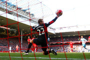 Jack Colback of Newcastle United scores past Simon Mignolet of Liverpool to equal the scoring during the Barclays Premier League match between Liverpool and Newcastle United at Anfield on April 23, 2016 in Liverpool, United Kingdom.