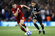 Neymar of Paris Saint-Germain runs with the ball under pressure from Jordan Henderson of Liverpool during the Group C match of the UEFA Champions League between Liverpool and Paris Saint-Germain at Anfield on September 18, 2018 in Liverpool, United Kingdom.